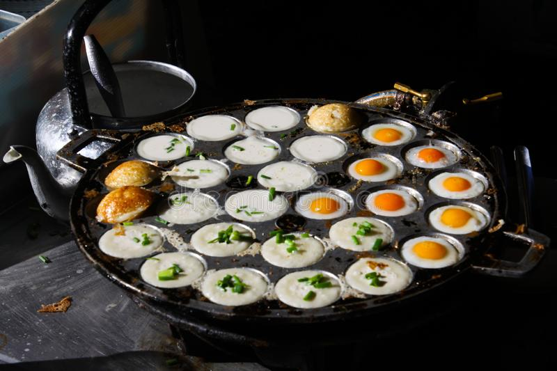 Thai street food in Chiang Mai with fried eggs and coconut pudding pancakes royalty free stock photography