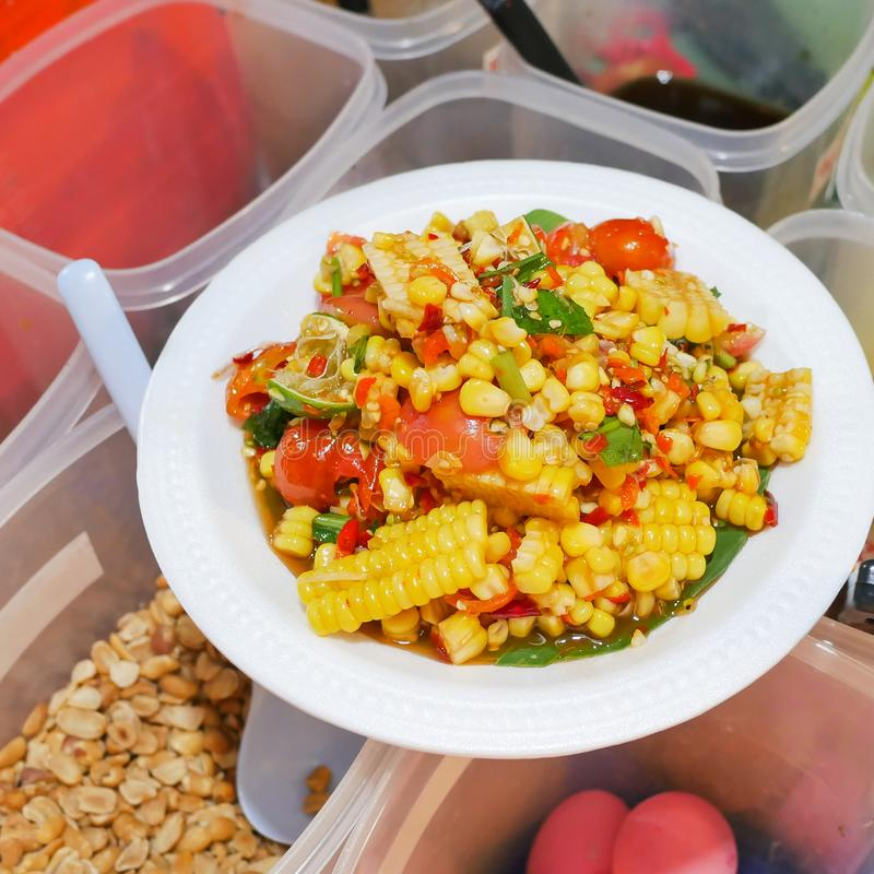 Thai street food, Spicy fruits salad mixed with corn and tomato on white plate-soft focus royalty free stock photography
