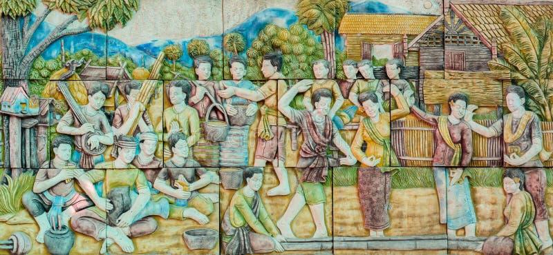 Thai stucco art of Thai folk dance stock images
