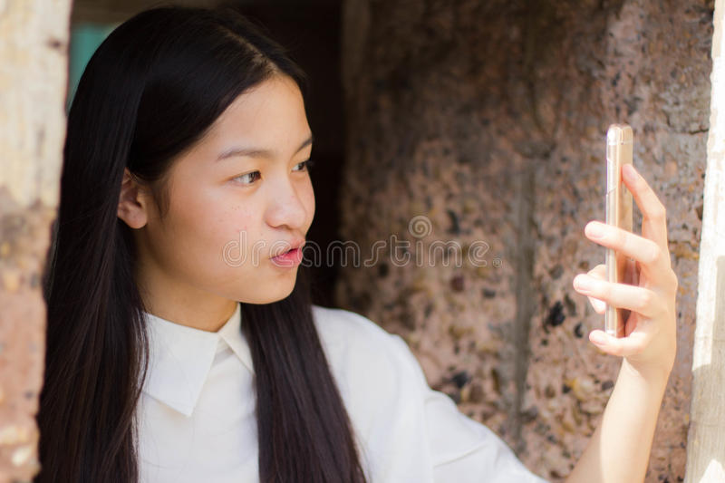 Thai student teen beautiful girl relax and smile. royalty free stock photo