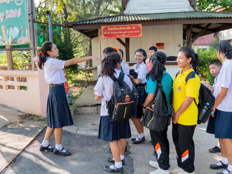 Thai students are lining up and being checked before leave school to home every evening at school. Hua Hin, Thailand September 10 royalty free stock photography