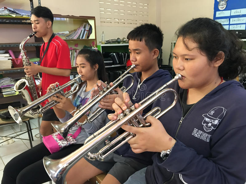 Thai students play instruments royalty free stock images