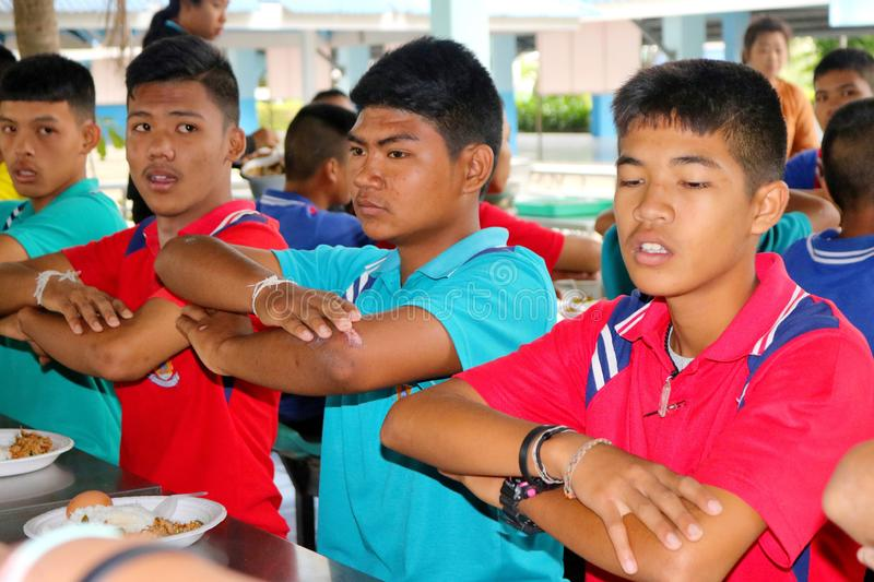 Thai students sitting in school's canteen waiting to eat their l royalty free stock photo