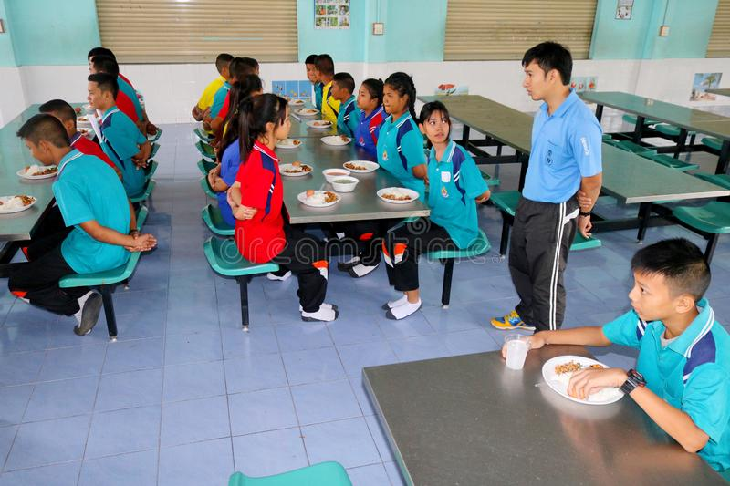 Thai students sitting in school's canteen waiting to eat their l royalty free stock image