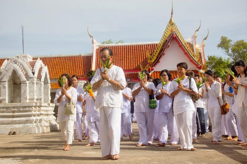 Thai students wear white clothes making a merit at the temple in Pranburi, Thailand July 21,2017 royalty free stock images