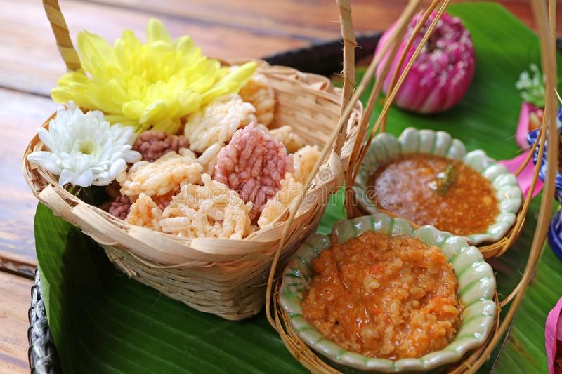 Thai Style Appetizer of Crispy Fried Rice Cakes with Sweet and Spicy Dips. Thai traditional food asian banana basket beautiful bite bowl ceramic chili close royalty free stock photography