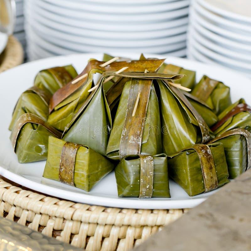 Thai style dessert, Khanom Sod-Sai (Steamed Flour with Coconut F. Closeup Thai style dessert, Khanom Sod-Sai (Steamed Flour with Coconut Filling). - finger food royalty free stock photo