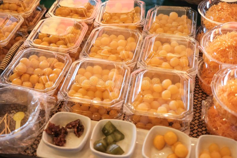 Thai style desserts in plastic boxes royalty free stock photo