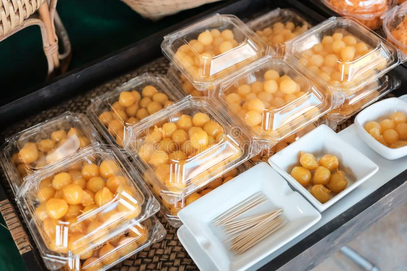 Thai style desserts in plastic boxes. royalty free stock photos