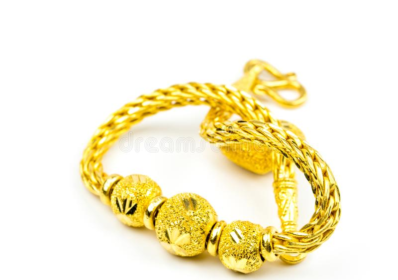 Thai style gold jewelry bracelet isolated on white background with copy space. Just add your own text. Chinese New Year gift. Gold shop business royalty free stock photo