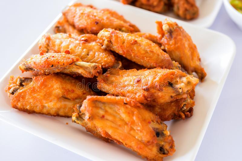 Thai style homemade fried chicken wings on white plate stock images