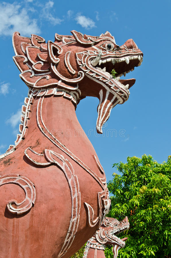 Thai style lion statue with blue sky