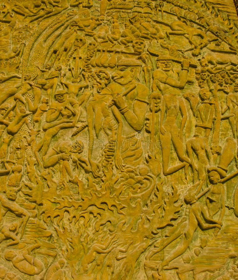 Thai Style Moral Carve On The Stone Wall. Royalty Free Stock Photo