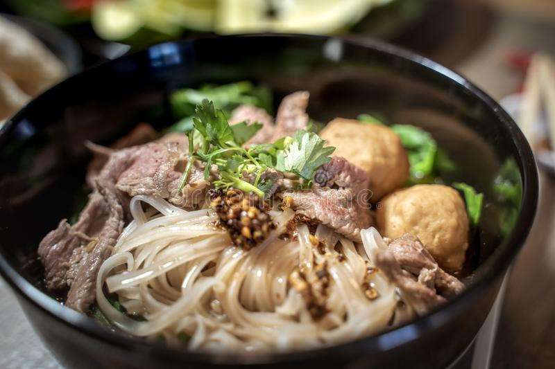 Thai style noodle blood soup,boat noodle,delicious dish,famous Thai noodle soup. Thai peoples call Boat Noodles. Close up or selective focus royalty free stock photo