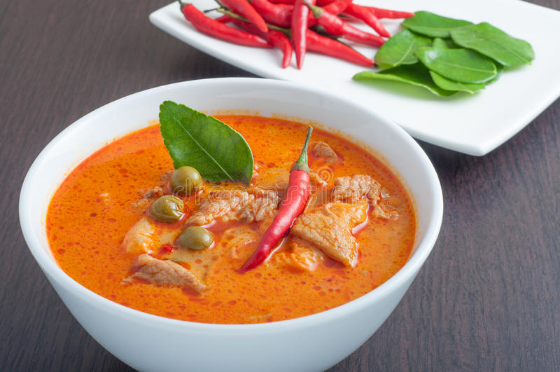 Thai style pork curry. With chilli and lime leaf stock images
