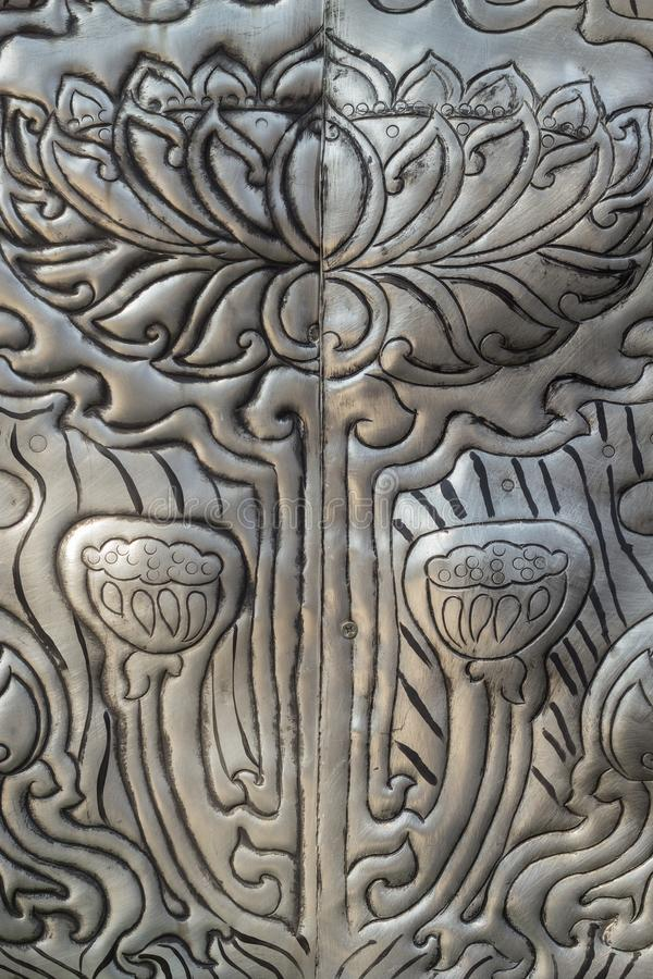 Thai style silver carving art on temple wall , Wat Srisuphan ,Chiang Mai, Thailand . stock photos