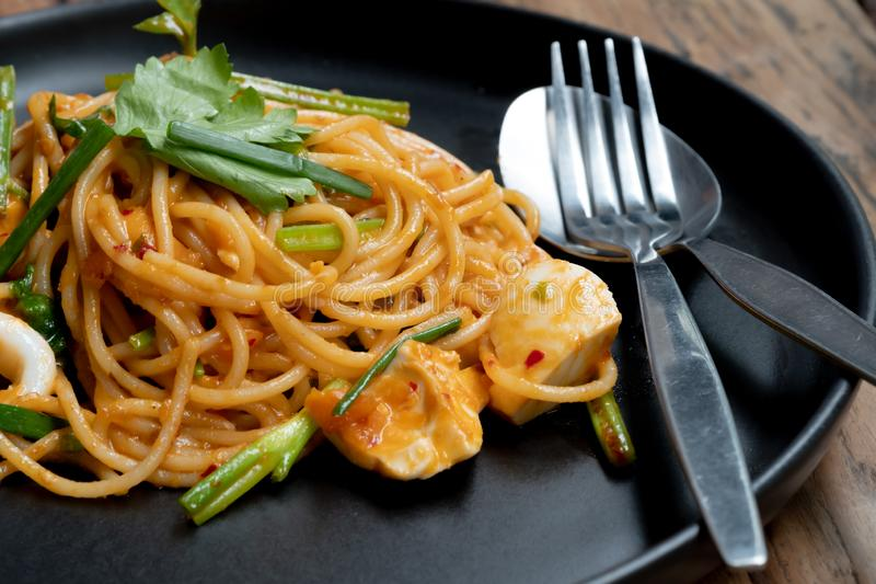Thai style spaghetti. Salt eggs cream sauce mixed with seafood. Tasty contemporary dish for everyone stock photography