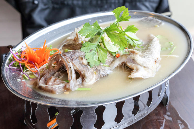 Thai style steam seabass fish royalty free stock photography