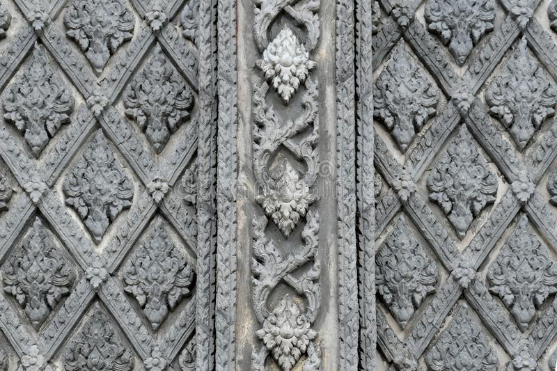 Thai style stucco on the wall and temple wall royalty free stock photo
