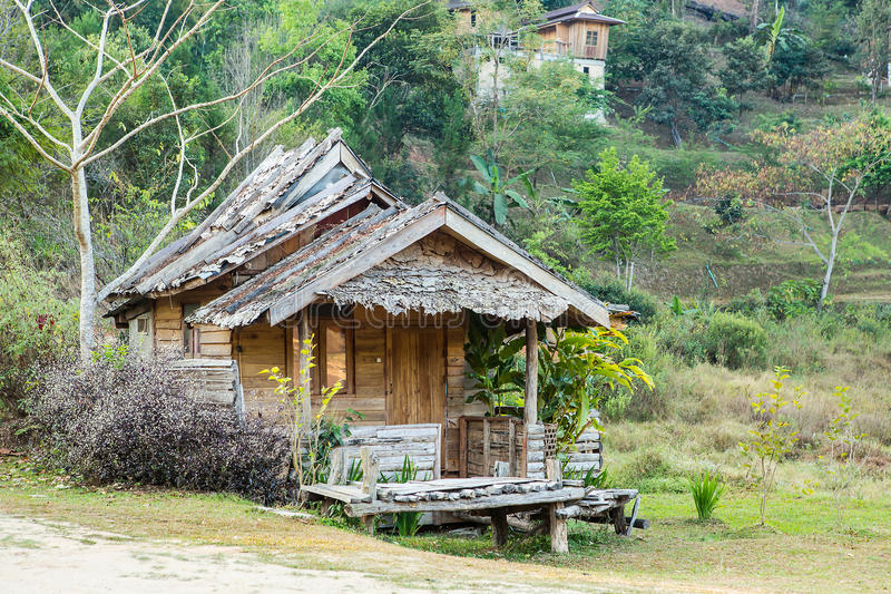 Thai style wooden hut of hill-tribe, Thailand. Wooden hut in the mountains with trees stock images