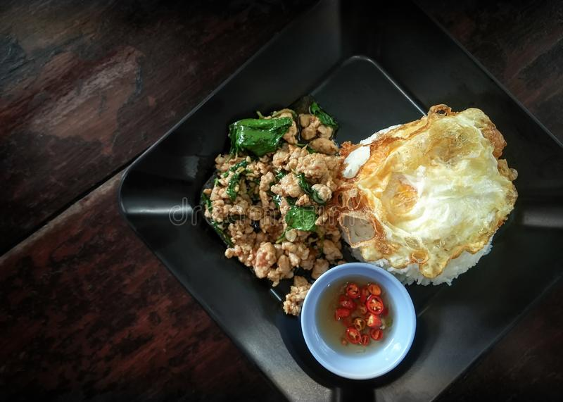 Thai Styled Pan Fried Ground Pork with Basil over Rice.  stock images