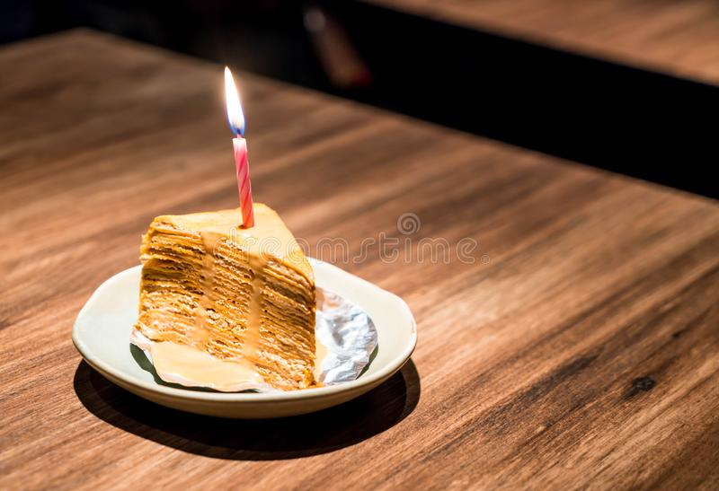 Thai tea crape cake. With happy birthday candle royalty free stock images