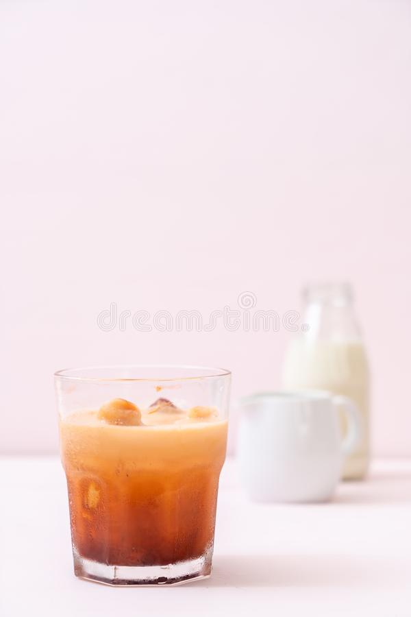 Thai tea ice cube with milk stock photography