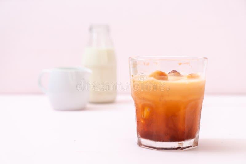 Thai tea ice cube with milk. On wood background royalty free stock photo