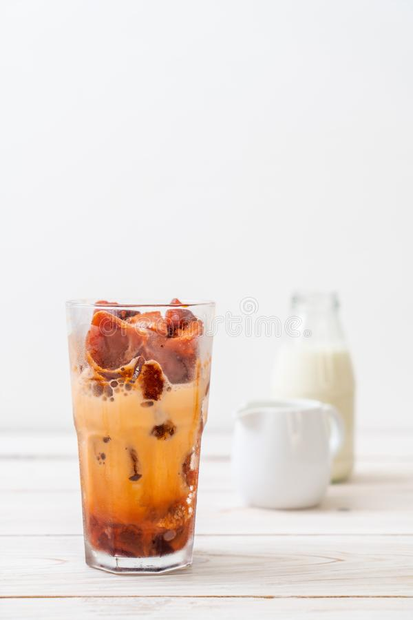 Thai tea ice cube with milk. On wood background stock images