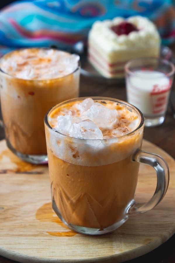 Thai tea milkshank sweet drink on the glass for refreshment.  stock image