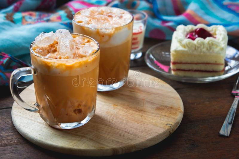 Thai tea milkshank sweet drink on the glass for refreshment.  stock photography
