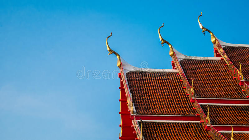 Thai Temple roof with blue sky background. Thai Temple roof with blue sky background royalty free stock photo