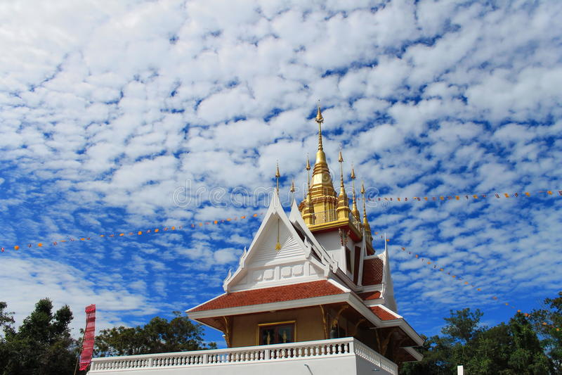 Thai Temple under blue sky stock images
