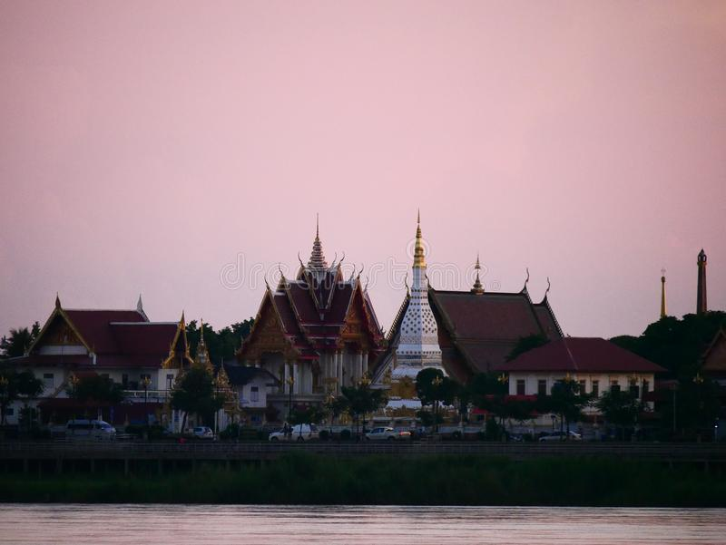 Thai temple `Wat Thai` evening waterfront river side Mekong River. At Naklorn Phanom in Thailand stock photos