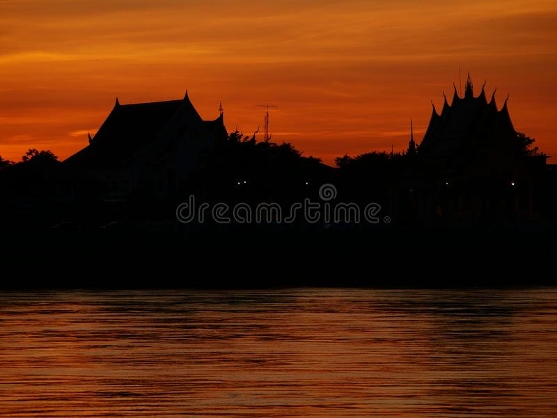 Thai temple `Wat Thai` evening waterfront river side Mekong River. At Naklorn Phanom in Thailand stock image