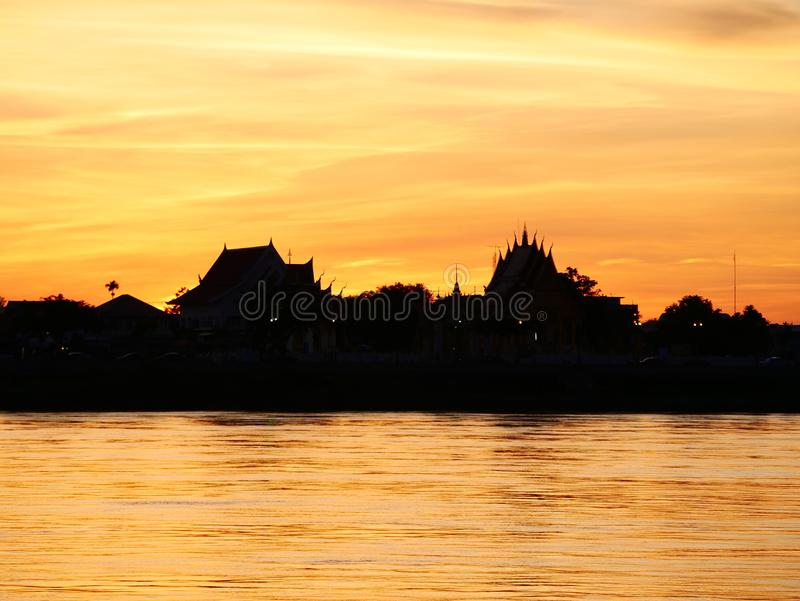 Thai temple `Wat Thai` evening waterfront river side Mekong River. At Naklorn Phanom in Thailand stock photo
