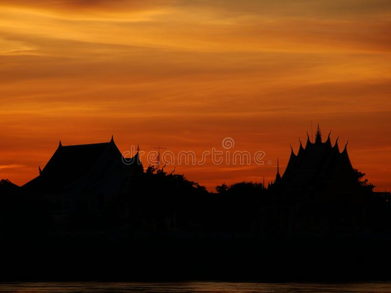 Thai temple `Wat Thai` evening waterfront river side Mekong River. At Naklorn Phanom in Thailand royalty free stock image