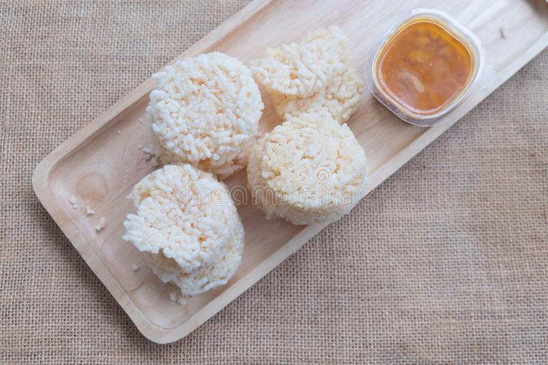 Rice cracker with spicy dipping sauce stock images