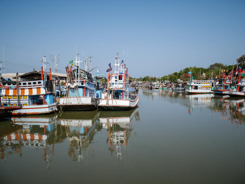 Thai traditional fishing boat, quiet and peaceful water with blue sky royalty free stock images