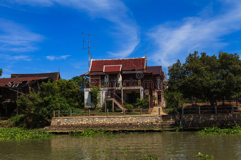 Thai traditional house along the river, Living with natural. Take photo from river stock image