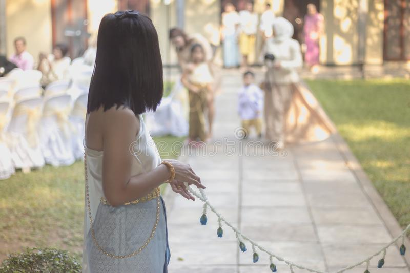 Thai Traditional Wedding Ceremony. Barring the Groom from Approaching the Bride. royalty free stock photography