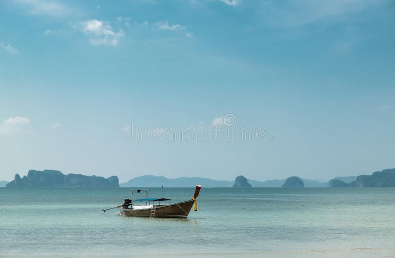 Thai traditional wooden boat on the beautiful beach in Krabi province. Thailand. stock photo