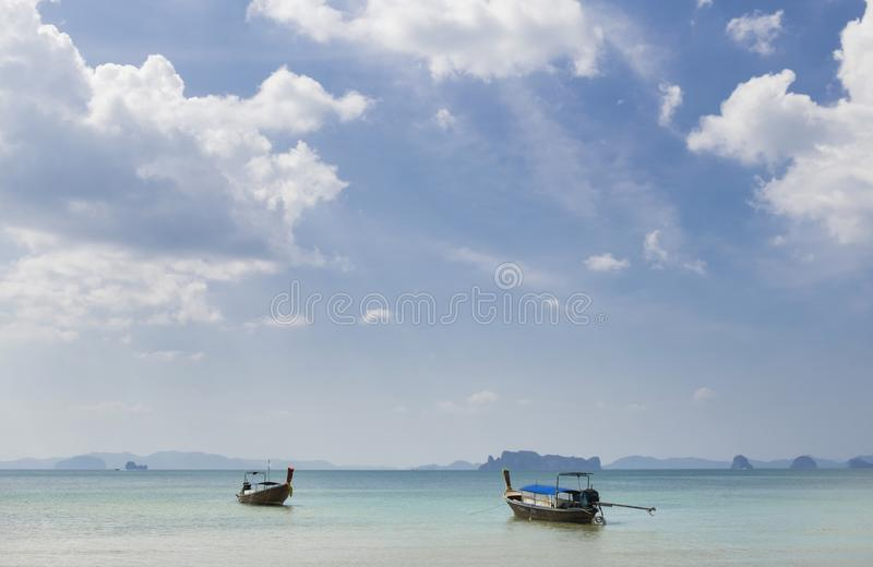Thai traditional wooden boats on the beautiful beach in Krabi province. Thailand stock image
