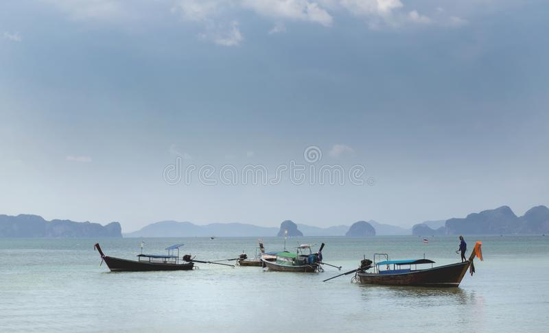 Thai traditional wooden boats on the beautiful beach in Krabi province. Thailand royalty free stock images