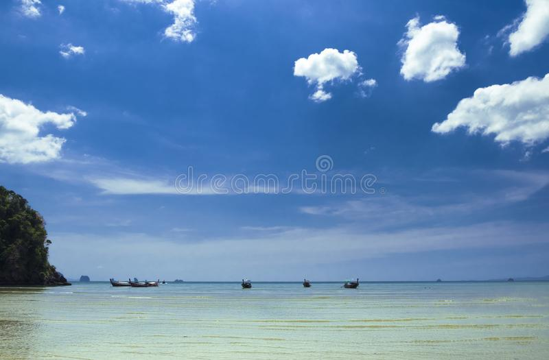 Thai traditional wooden boats on the beautiful beach in Krabi province. Thailand stock photo