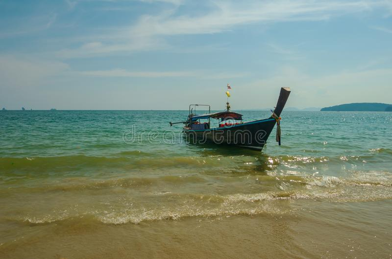 Thai traditional wooden long tail boat beach sand  Ao Nang, Krabi, Thailand. Thai traditional wooden long tail boat beach sand  Ao Nang, Krabi stock photo
