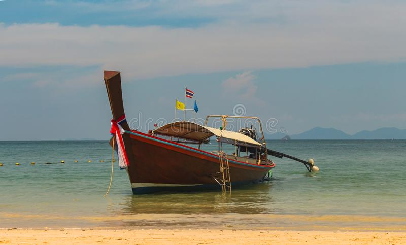 Thai traditional wooden long tail boat And Stone Mountain is located at the beautiful sea. Summer beach clean water for relaxation royalty free stock photo