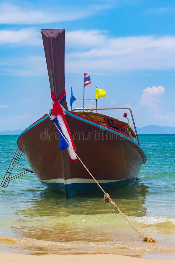 Thai traditional wooden long tail boat And Stone Mountain is located at the beautiful sea. Summer beach clean water for relaxation. Of beach sand  Ao Nang stock photography