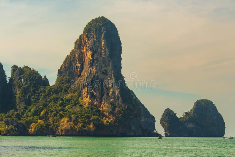 Thai traditional wooden long tail boat And Stone Mountain is located at the beautiful sea. Summer beach clean water for relaxation. Of beach sand  Ao Nang stock images