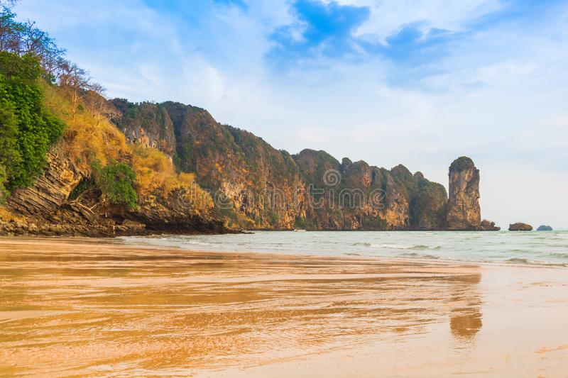 Thai traditional wooden long tail boat And Stone Mountain is located at the beautiful sea. Summer beach clean water for relaxation. Of beach sand  Ao Nang stock image